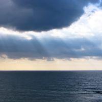 Cloudy sky with sun rays, Бат-Ям