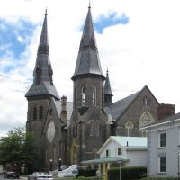 First Presbyterian Church.  These steeples are a distinctive mark on the Brockville skyline.  Does the one steeple look crooked to you? It is, and it was built that way.  It is clad in slate tiles., Броквилл