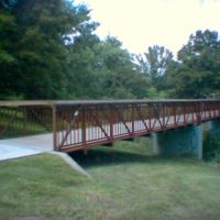 The Pine Creek pedestrian bridge in the full light of day., Пикеринг