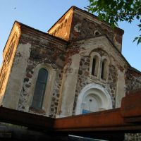 Rusty cross laying near All Saints Ortodox Church in Biahomĺ, Бегомль