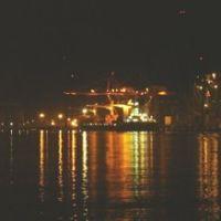 vista nocturna de los muelles, Алтотонга