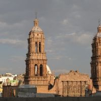 The towers of the cathedral behind a rooftop, Закатекас