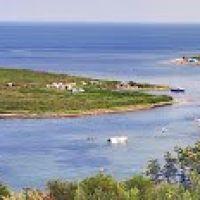 Остров Ахлестышева. 1895-1912 гг. назывался о-в Луценко., Русский