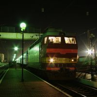 Electric locomotive ChS4T-697 with train Rostov - Adler on train station Bataysk, Батайск