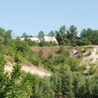 Дом на вершине холма над прудом, Тацинский