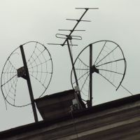 Funny TV antennas at roof of house on Petrovskaya embankment, Выборг