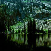 Dark waters of Center Creek Lake. Frank Church Wilderness, Маунтейн-Хоум