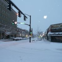 A snowy morning in downtown Casper, Wyoming. Viewing east on E. 2nd St., from its intersection with S. Wolcott St., Каспер