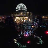 Hans Fräbels marvelous glass sculpture Large Cube with Imploded Glass Spheres in the Sunken Garden at Lewis Ginter Botanical Garden, illuminated for the holidays as part of the GardenFest of Lights, with the dome of the Conservatory beyond, 1-9-11, Лейксайд