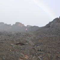 2014-05-01 A hiker by some ancient lava fissure under rainbow., Канеоха