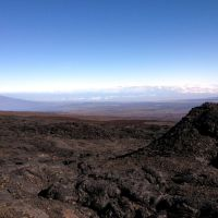 2012-04-29 Distant hiker observes Hualalai volcano from Mauna Loa slopes., Лиху