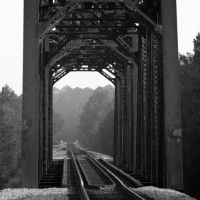 Ocmulgee River Bridge, Lumber City, Georgia. This through-truss SouthernRailway bridge once rotated on its center pier to allow Steamboats to pass.  Southern also maintained wharves on the riverbank to transfer freight to and from the boats.  No trace of , Вхигам