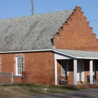 Goggans General Store, Goggans, Georgia.  Goggans was named for the family of John F. Goggans.  He donated the land for the railroad station, general store, where the post office was located, and access land to the Union Primitive Baptist Church.  At diff, Макон
