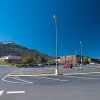 Looking out West across the parking lot of Raleys Supermarket, Oakhurst CA, 2/2011, Вест-Атенс