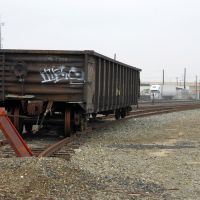 An empty scrap car sits on a spur off of the mainline of the Union Pacific tracks just south of downtown Modesto, 12/2012, Модесто