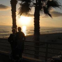 Erika and Bobby Sounakhene Silouetted on Rubys Pier at Sunset in Oceanside, CA, Оушнсайд