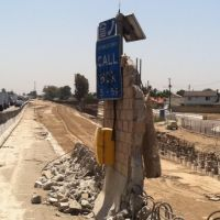 Looking southerly on I-5, the call box marks the old edge of pavement.  The rebars protruding above the ground on the lower right mark the alignment of the new soundwall. (7/24/2013), Санта-Фе-Спрингс