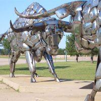 Two Steers  by John Kearney, also called Bumper Bulls, 2 life-size bulls made of vehicle bumpers, Kansas Coliseum, Wichita,KS, Кечи