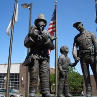 Protectors, Police Officer Firefighter Memorial, bronze of fireman with girl and boy looking up to police officer, Shawnee Safety Center, Shawnee,KS, Овербрук