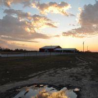 even mud puddles can be pretty at sunset, US 59 and MO 45, Missouri, Овербрук
