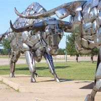 Two Steers  by John Kearney, also called Bumper Bulls, 2 life-size bulls made of vehicle bumpers, Kansas Coliseum, Wichita,KS, Парк-Сити