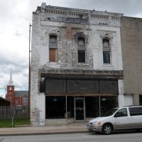 Old building in Nevada, MO still carrying the name of the store Harry Moore Dry Goods Co that closed in 1885, Невада