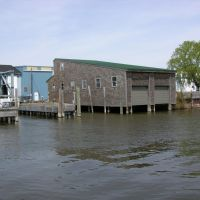 Boat house on Bear lake Channel. At Pointe Marine, Нортон Шорес