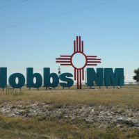Sign on US62 & US180 at western edge of Hobbs, NM, Татум