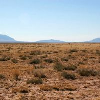 """Somewhere out across this New Mexican desert is """"Trinity Site"""", where the first atomic bomb was detonated, Харли"""