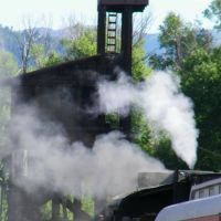 Train about to leave the station in Chama, Чама