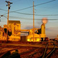 Carey, OH USA cement plant and railroad yard at sunset, Харрод