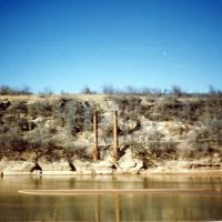 Remains of suspension bridge on the Red River, known as burned out bridge. Photo by R. Rogers., Жеронимо