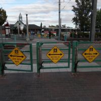 Bilingual danger signs at Beaverton Transit Center, Бивертон