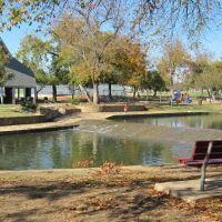 Pavilion, dam, and kids playground in Watterworth Park (view across Rawhide Creek), Фармерс-Бранч