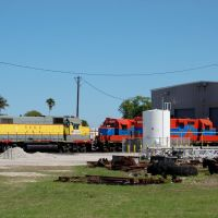 United States Sugar Corporation EMD GP38AC No. 404, South Central Florida Express Railroad EMD GP18 No. 9025 and No. 9026 at Clewiston, FL, Гарлем