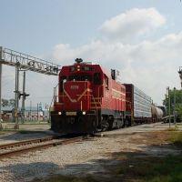 Florida Midland Railroad Local Freight Train, with Florida Central Railroad EMD/ATSF CF7 No. 56 providing power, crosses Lake Shipp Drive at Eloise, FL, Элоис