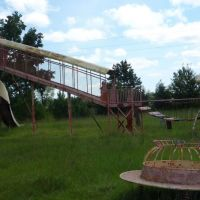 Abandoned Family Inns of America, steel play structure, Rowland, North Carolina., Пайнридж