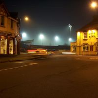 Manor Park floodlights from Cock & Bear roundabout, Нунитон