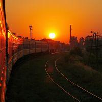 Ukraine - view on the sunrise from window of train, Токмак