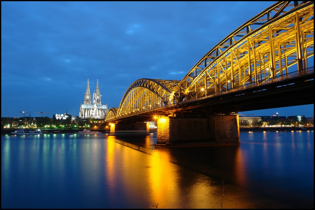 Winner of Honorable Mention Contest MAY 2011- Blue Hour in Cologne - 30 sec.- River Rhine,  Hohenzollernbrücke , the Dom Cathedral of Cologne - UNESCO World Heritage - Germany - [By Stathis Chionidis], Кельн