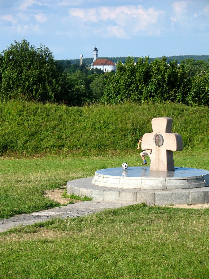 Boy playing football at the site of ancient settlement 'Zamečak' in Zaslaŭje. The cross in honour of 1000 years of Orthodoxy in Belarus, Заславль