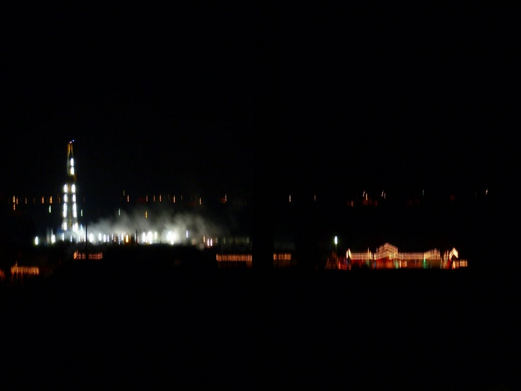 Oil rig, out of focus, in the cold night., Ганнисон
