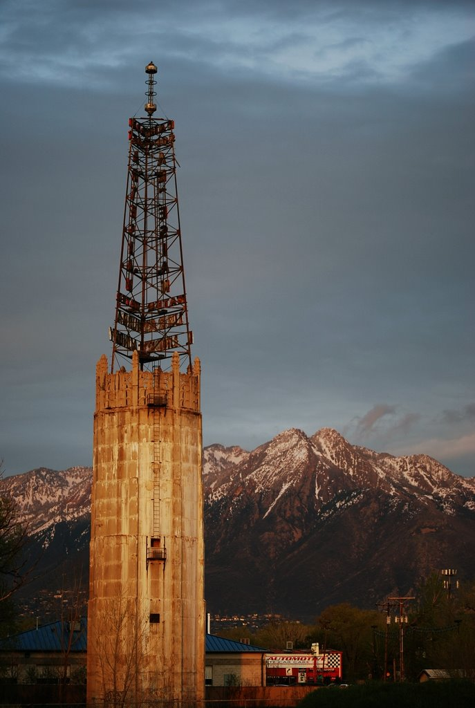 Rain soft water tower at sunset with the Wasatch mountains in the background., Муррей